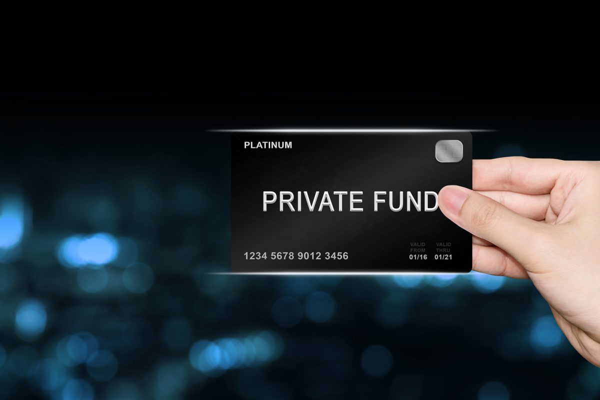 hand picking private fund platinum card on blur background