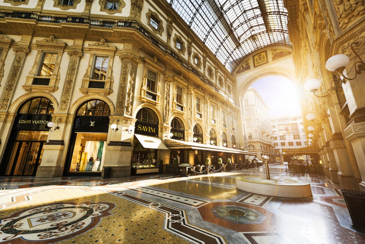 MILAN ITALY - AUGUST 29 2015: Luxury Store in Galleria Vittorio Emanuele II shopping mall in Milan with shoppers and tourists strolling around. Prada is an Italian luxury fashion house founded in 1913